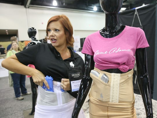 Anna Taylor shows some of the shape wear she designed to allow women to carry a concealed firearm. Taylor's company is called Dene Adams, named after her grandfather who taught her gun safety and how to shoot.