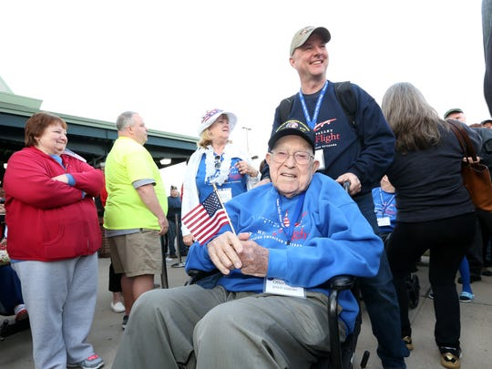 John Kahrs, an Iraq & Afghanistan War veteran assists Eddie Otterstedt, a WWII veteran during the Hudson Valley Honor Flight on April 14, 2018 at Stewart Airport.
