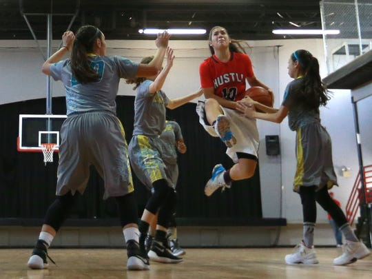 Jessica Amezaga of the El Paso Hustle attempts to go between four Bonafide defenders during a recent game. Teams will be competing in the Latino World Championships in June in El Paso.