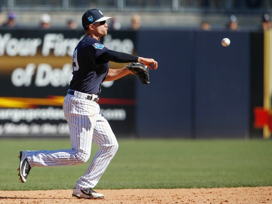 New York Yankees second baseman Tyler Wade (39) throws to first base for the out during the sixth inning against the Tampa Bay Rays at George M. Steinbrenner Field.