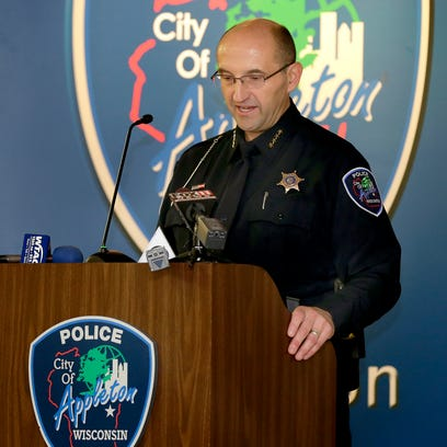 Appleton Police Chief Todd Thomas speaks after being