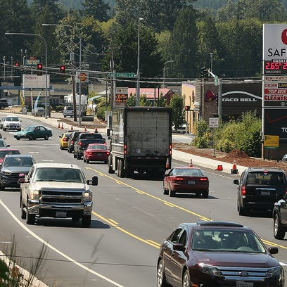 Traffic moves along Highway 3 in Belfair on Tuesday,
