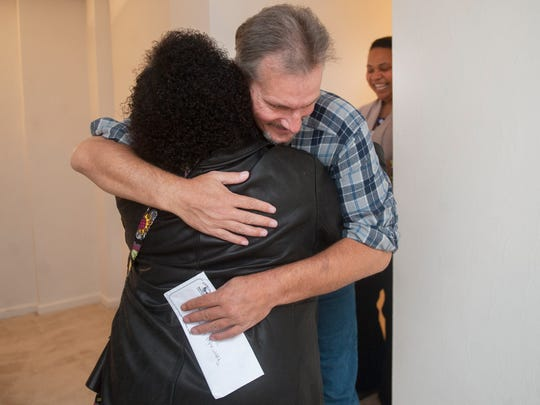 Kenneth, left,  a 47-year-old with end-stage liver disease, hugs behavior specialist Dorothy Scott of South Jersey Behavioral Health Resources shortly after Kenneth entered his new apartment in the Heights of Collingswood for the first time that he recieved thanks to a pilot project led by the Camden Coalition of Healthcare Providers.  11.11.15
