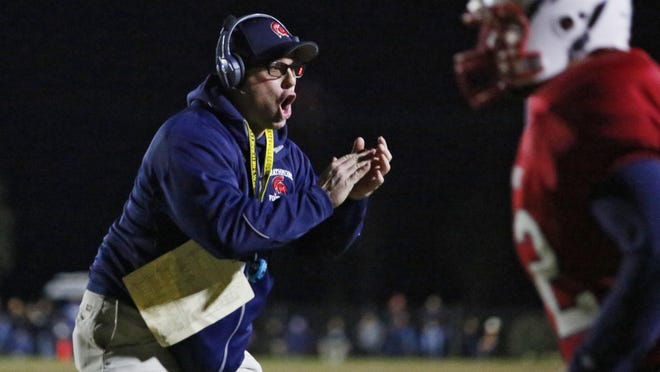 Strathmore's coach Jeromy Blackwell gets his team motivated against St. Patrick-St. Vincent during a CIF State Division 6-A Championship Bowl Game in Strathmore, Calif., Saturday, Dec. 17, 2016.
