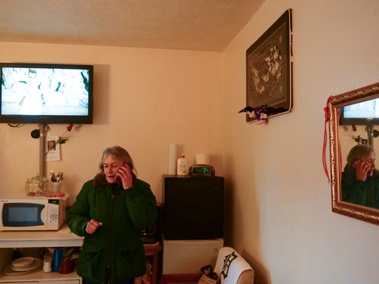 Belinda Cipko makes a call from her home at the Burkewood Inn in Lansing earlier this year.