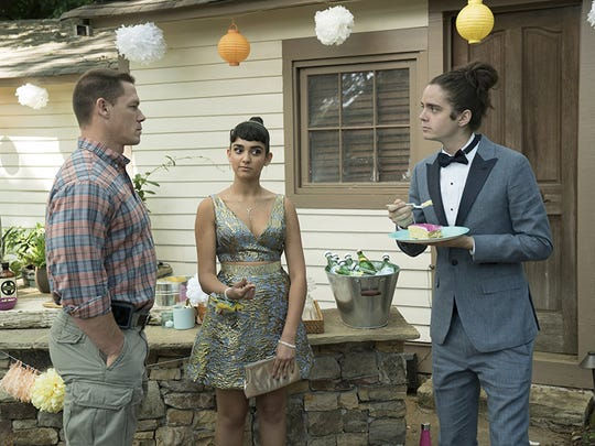 "John Cena (left) plays a dad determined to stop his daughter (Geraldine Viswanathan) from making a big mistake with her prom date (Miles Robbins)  in ""Blockers."""