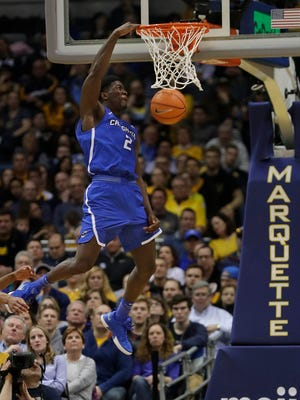 Creighton's Khyri Thomas rises for a slam against Marquette at the BMO Harris Bradley Center in March.