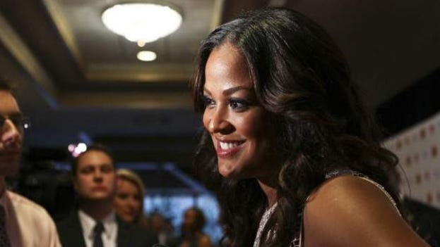 Laila Ali, a daughter of Muhammad Ali, talks to the media on the red carpet. The awards ceremony was presented by the Yum! Brands Foundation.