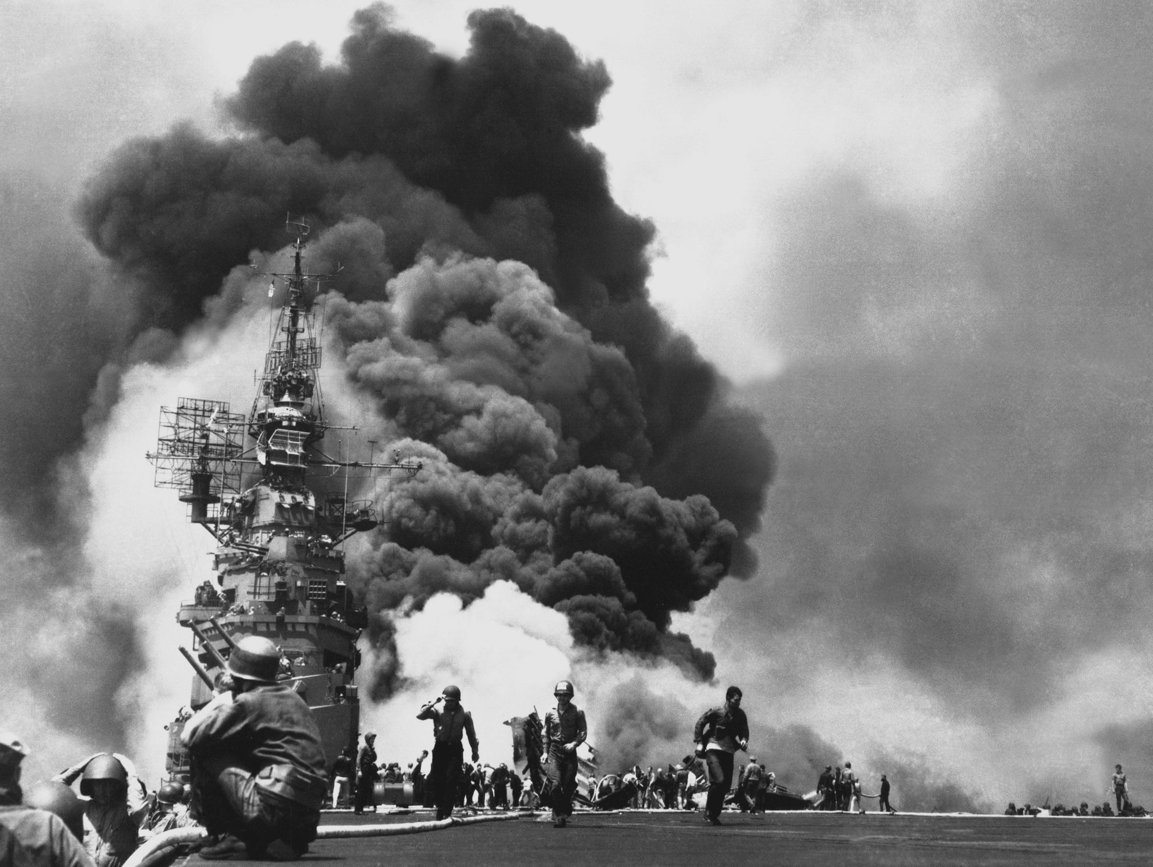 USS BUNKER HILL hit by two Kamikazes in 30 seconds