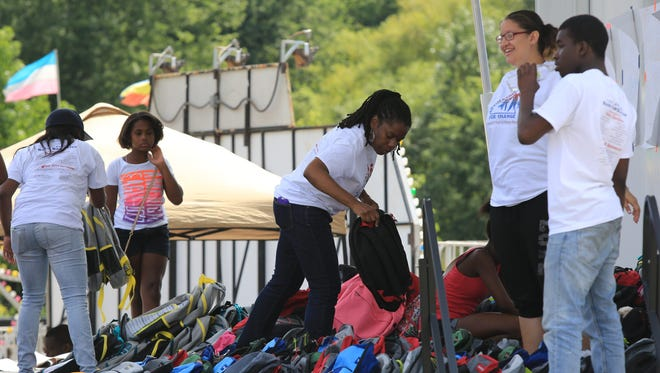 Advocating For Change distributed 900 backpacks filled with school supplies for children in Spring Valley at Memorial Park on Aug. 30, 2014.  (Carucha L. Meuse / The Journal News)