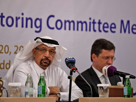 Saudi Energy Minister Khaled al-Faleh, left, and Russian