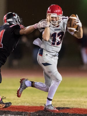 Coronado's Jay Vanderjagt (#13) is almost sacked by Dysart's Simeon Rivera (#51) in the second quarter of their high school football game on Friday, Oct. 28, 2016, at Dysart High School in El Mirage, Ariz.