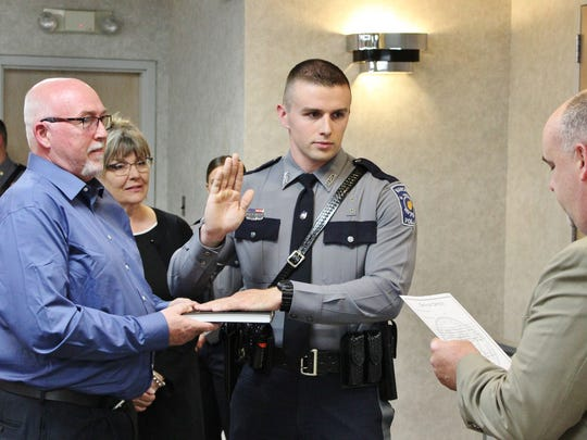 Gavin Reilly, 23, of Toms River, takes the police oath at his swearing-in May 1.