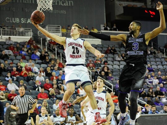 Southern Indiana guard Alex Stein (20) goes to the hoop past Kentucky Wesleyan forward Sam Williams (3) during the Small College Basketball Hall of Fame Classic at the Ford Center in Evansville, Saturday, Nov. 19, 2016. Southern Indiana beat Kentucky Wesleyan 85-81.