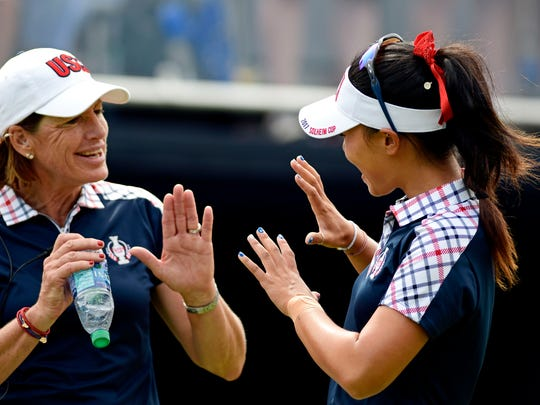 Aug 20, 2017; West Des Moines, IA, USA; USA captain Juli Inkster and Danielle Kang on the first tee in the final round of The Solheim Cup international golf tournament at Des Moines Golf and Country Club. Mandatory Credit: Thomas J. Russo-USA TODAY Sports