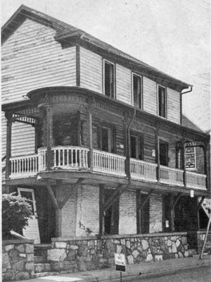 Bill Brown of the Staunton Leader photographed the Pannell house in the early stages of its demolition in 1977. The logs that made up one of the town's pioneer-era structures can be seen exposed about 12 feet above street level on the overhanging porch.