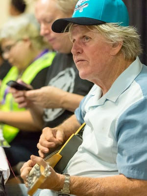 Hollywood actor Gary Busey strums a guitar in-between signing autographs during the Las Cruces Comic Con on Saturday August 26, 2017 at the Las Cruces Convention Center.