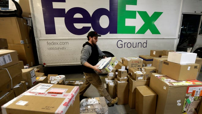 FedEx said Monday that it expects record package volume during the holiday season this year, as more consumers shop online.
