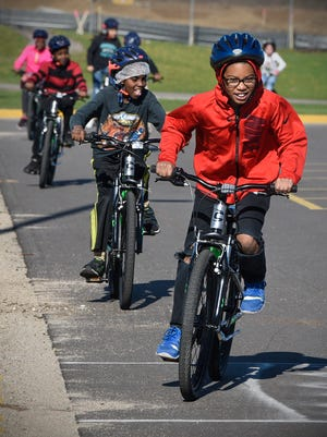 Fourth-graders take their turns riding bikes during physical education class Thursday, May 11, at Discovery Community School in Waite Park. The bikes are provided by BLEND to local schools.