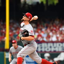 Reds starting pitcher Mike Leake throws against the St. Louis Cardinals in the first inning at Busch Stadium.