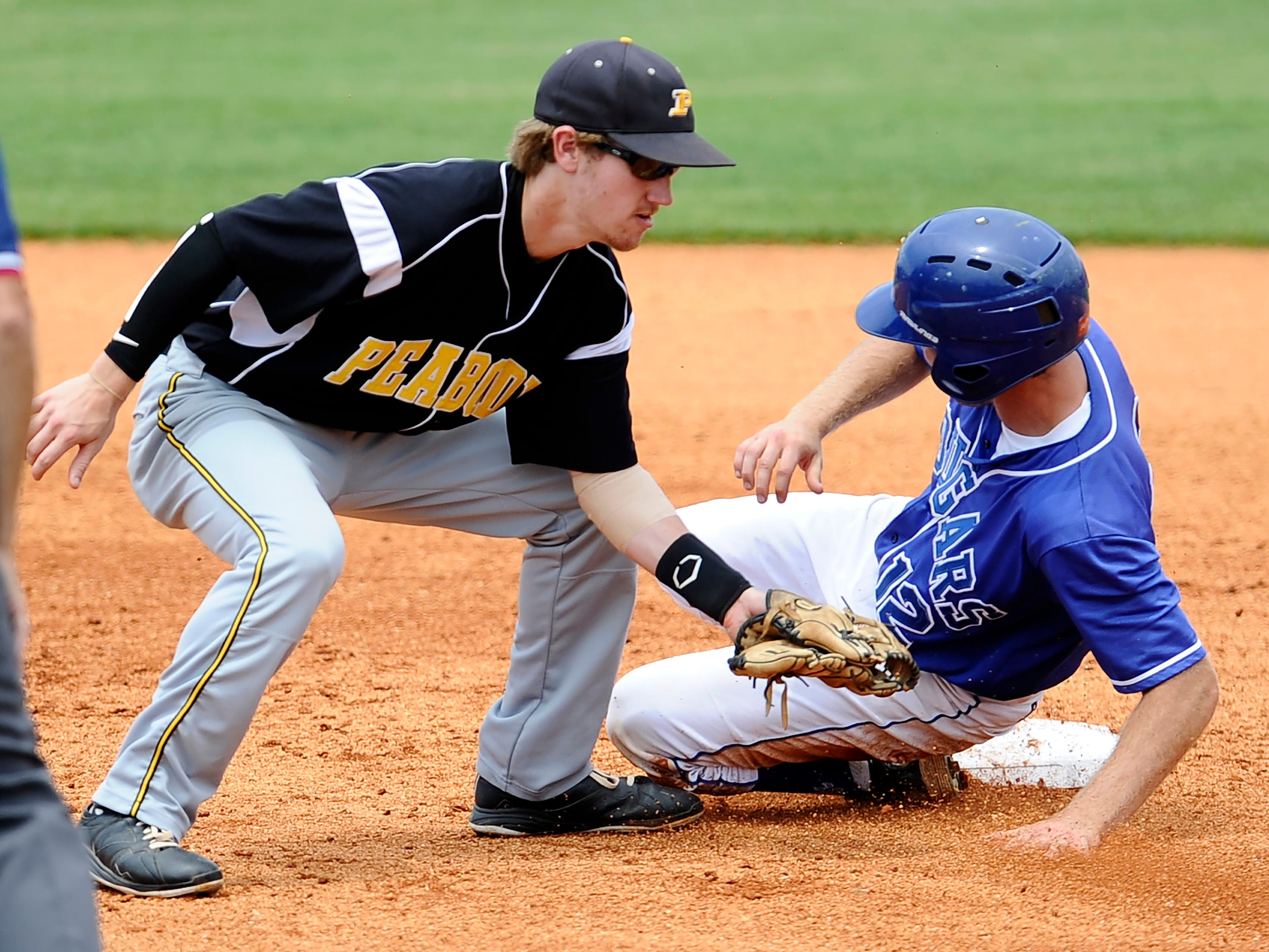 Trenton Peabody's Daniel Hodges (15) tries to tag out Goodpasture's Jordan Goff (12) as he steals second base on Wednesday.