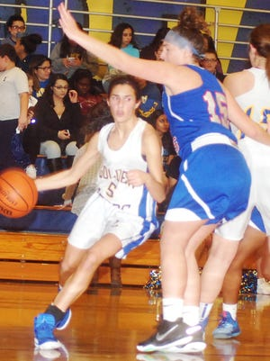 Lyndhurst guard Grace Cappiello (5) trying to turn the corner against Lodi's Sara Papraniky.