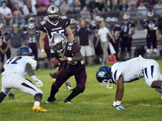 Shippensburg's Zion Ware, center, faces off against Warren Lee, of Chambersburg, on Friday night. Ware carried the ball 20 times for Ship and gained 181 yards in a 26-21 win over the Trojans.