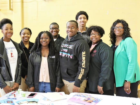 Top Teens Mya Phillips, Kalyn Mclemore, Demeka Yarbrough, Derryus Shaw, Charles Adams and Dominic Phillips; and sorority members Margaret Adams and Cynthia Early, pose for a photo during the 21st annual Youth Symposium hosted by Sigma Gamma Rho Sorority on March 10 at North Side High School in Jackson.