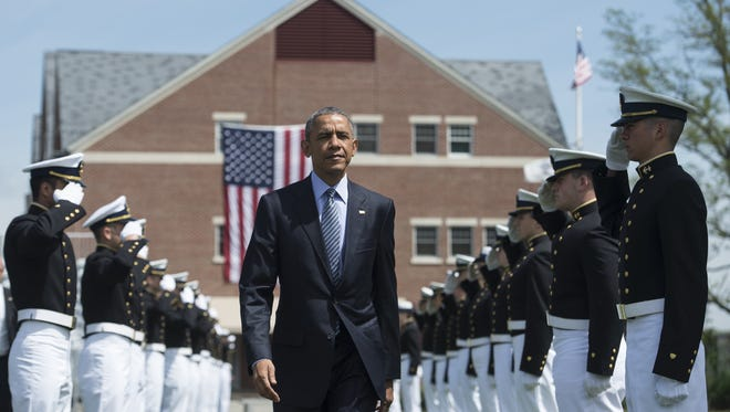 President Obama arrives to deliver the keynote address during the 134th Commencement Exercises of the United States Coast Guard Academy in New London, Conn. Wednesday.