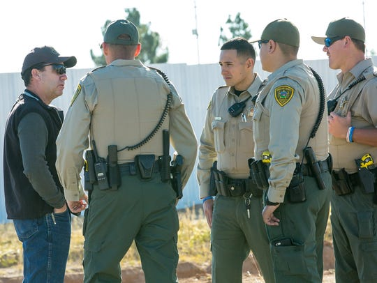 Members of the Doña Ana Sheriff's Office gather at