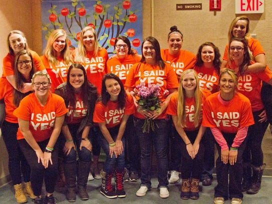 Danika Newberry, center, poses with her sorority sisters