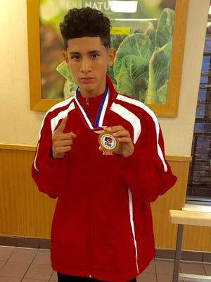 Santos Ortega, a freshman a La Quinta High, was one of two local boxers to win a gold medal at the Junior Olympics the last Saturday.