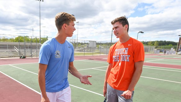 Daniel senior tennis captain Chris Aurich, left, works with teammate Matt Monaghan during practice Wednesday, April 25, 2018. The Lions are scheduled to host South Pointe in a Class AAAA second-round playoff match Tuesday.