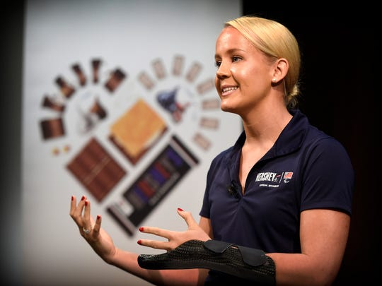 """Paralympic gold medal winner Molly Weggemann addresses Hershey employees and guests at Hershey Headquarters Wednesday, August 10. Weggemann was on hand to help kick off the """"#HelloFromHome"""" initiative. The campaign encourages fans to use the hashtag to send encouraging words to Team USA and to the Paralympic athletes, which begin their Olympics Sept. 7."""