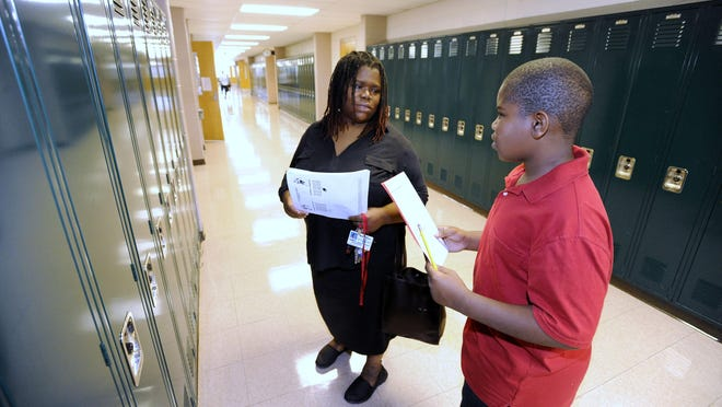 Loretta Price, left, 43, and her son, Tyrmon Price, 11, both of Eastpointe, find Tyrmon's locker. When East Detroit Public Schools students return to school in Eastpointe on September 6th, there will be a CEO in place helping the superintendent make important decisions on academics.