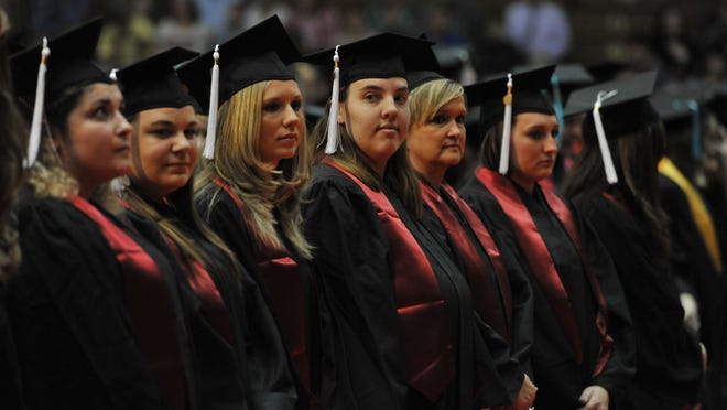 Graduates take their places for the 41st Indiana University East commencement Friday, May 11, 2012, in the Tiernan Center.