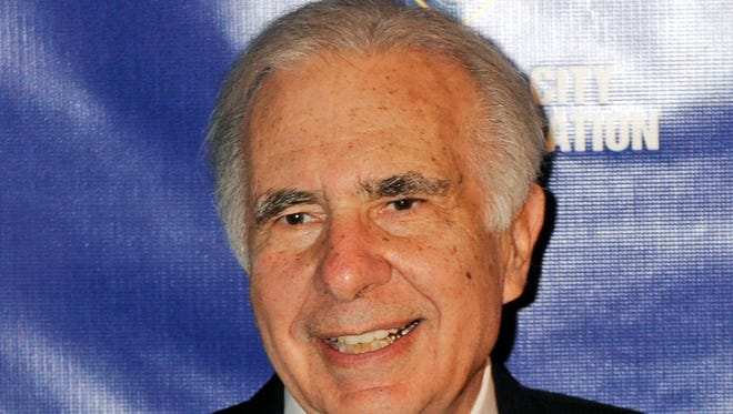 File photo taken in 2010 shows activist investor  Carl Icahn posing for photos upon arriving for the annual New York City Police Foundation Gala in Manhattank.