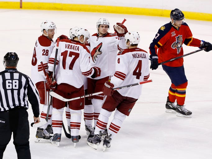 March 11, 2014 -Coyotes defenseman Oliver Ekman-Larsson (23) is congratulated after his goal against the Florida Panthers.