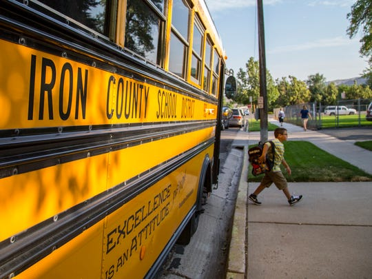 A student gets off the bus at East Elementary.