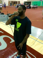 Aaron Camper on the mic, playing the MC role during