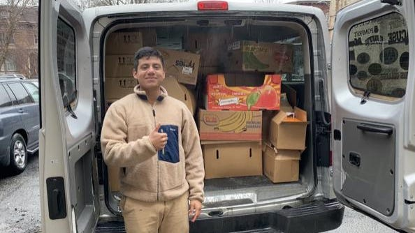 Luis Jimenez, San Miguel Academy 2013, Canterbury School 2017, SUNY Maritime, 202, distributing food from local restaurants to current San Miguel Academy students.