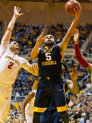 West Virginia Mountaineers guard Jaysean Paige (5) shoots over Iowa State Cyclones forward Abdel Nader (2) during the second half at the WVU Coliseum.