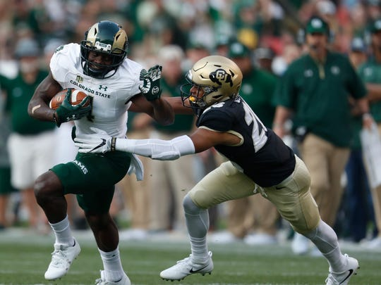 Colorado State Rams wide receiver Michael Gallup (4) and Colorado Buffaloes defensive back Isaiah Oliver (26) in the first half of an NCAA college football game Friday, Sept. 1, 2017, in Denver.