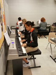 Students practice on keyboards recently installed at