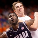 Boise State Anthony Drmic (3) locks up with Nevada player Cole Huff (13) during the first overtime at Taco Bell Arena.
