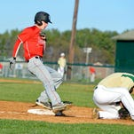 Riverheads' John Weeks steals third base as Wilson Memorial's Heath Hatfield fields the throw in the fourth inning of their game in Fishersville on Wednesday.