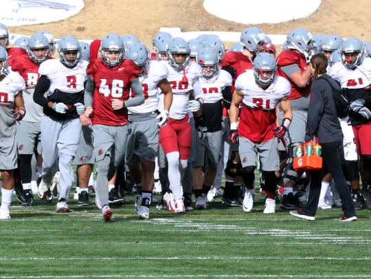 The Washington State Cougars run at the start of their