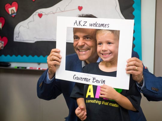 Kentucky Governor Matt Bevin take a photo with Fletcher Overton, 5, at the Audubon Kids Zone in Henderson, Ky., on Thursday, Oct. 12, 2017. Gov. Bevin spoke with many of the participants in the Audubon Kids Zone about their various projects in the organization such as photography.