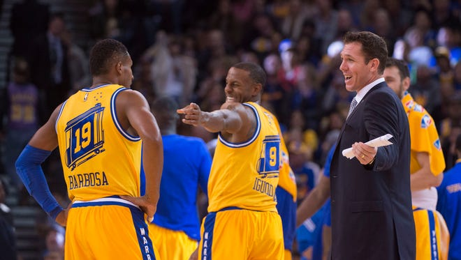 Golden State Warriors interim head coach Luke Walton (right) talks to guard Leandro Barbosa (19) and guard Andre Iguodala (9) during the third quarter against the Los Angeles Lakers at Oracle Arena. The Warriors defeated the Lakers 111-77.