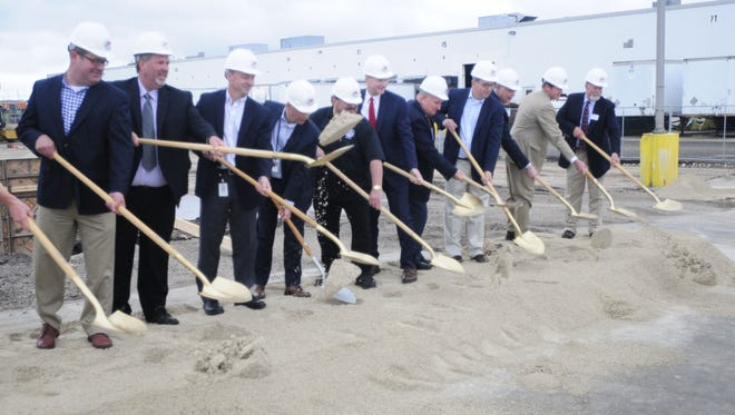 Mercury Marine President John Pfeifer, along with state lawmakers and local government and business leaders, lift their golden shovels during the groundbreaking ceremony for Mercury Marine's 45,000-square-foot expansion.